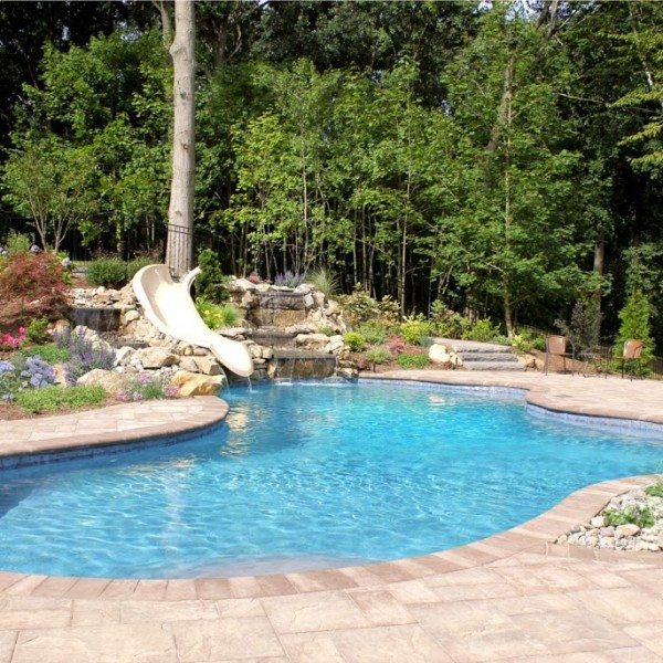24′ x 35′ Free Form Gunite Pool with Custom Bench, Slate Tile, and Big Ride Slide
