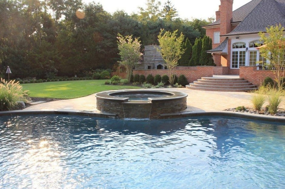Free-Form-Custom-Gunite-Pool-with-Sheer-Descent-Waterfalls-and-Spill-Over-Gunite-Spa-in-Old-Westbury