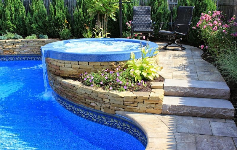 Hot-Tub-with-Spill-Over-and-Stone-Veneer-in-Merrick-NY