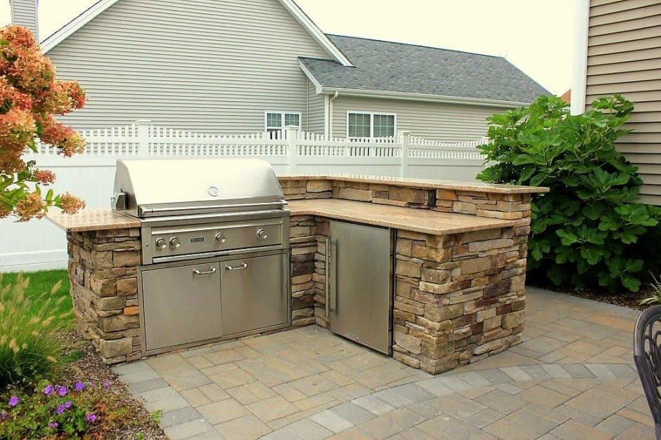 Custom-Bi-Level-Granite-topped-8x7-ft-Outdoor-Kitchen-veneered-with-Cultured-Stone-Southern-Ledgestone-and-outfitted-with-Bull-Outdoor-Products-Stainless-steel-Components