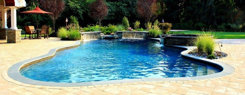 Free-Form-Gunite-Pool-with-twin-Sheer-Descent-Waterfalls-and-Spill-Over-Gunite-Spa
