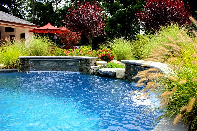 Landscape-planting-scheme-with-Thundercloud-Plum-trees-Maiden-Grass-Fountain-Grass-and-mixed-perennials-in-Old-Westbury-NY