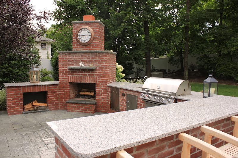 Outdoor Kitchen With Granite Countertop And Fireplace In Huntington NY