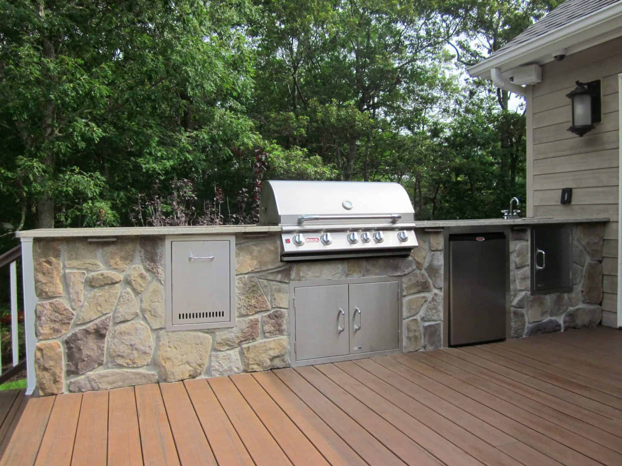 Outdoor kitchen and granite countertop veneered in Dressed Field Stone - Bucks County - Hampton Bays, Long Island NY