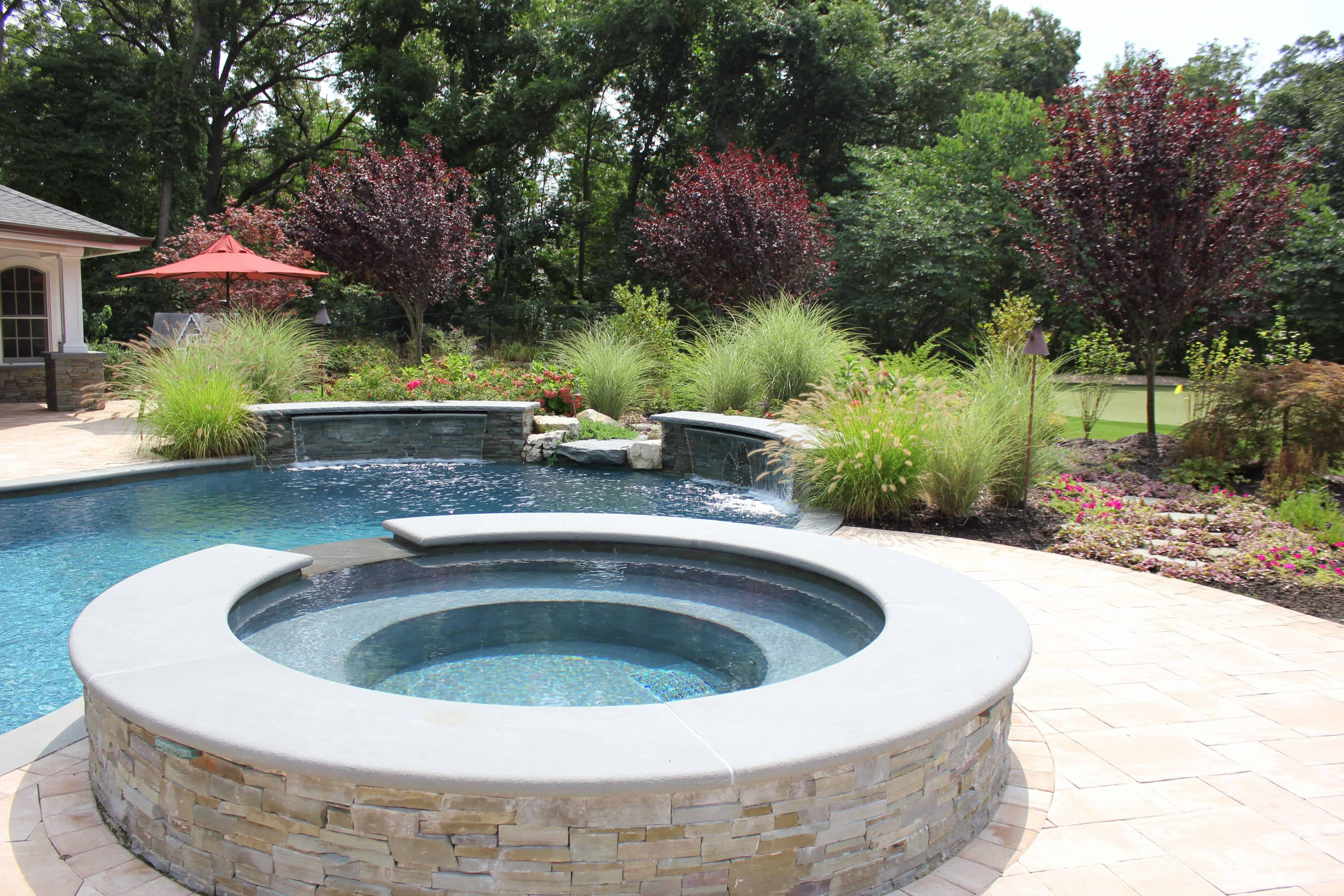 Custom Gunite Hot Tub with Spill Over veneered with stacked Bluestone and radial Bluestone Treads - Westhampton, Long Island NY