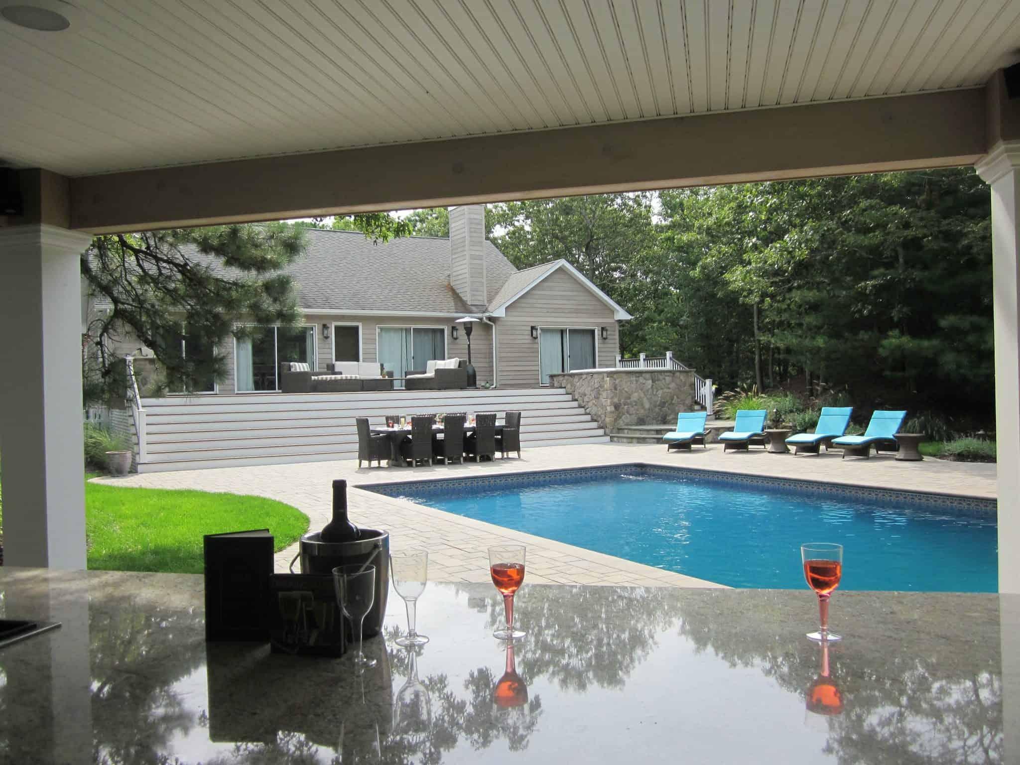 Outdoor bar and granite countertop veneered in Dressed Field Stone - Bucks County - Hampton Bays, Long Island NY