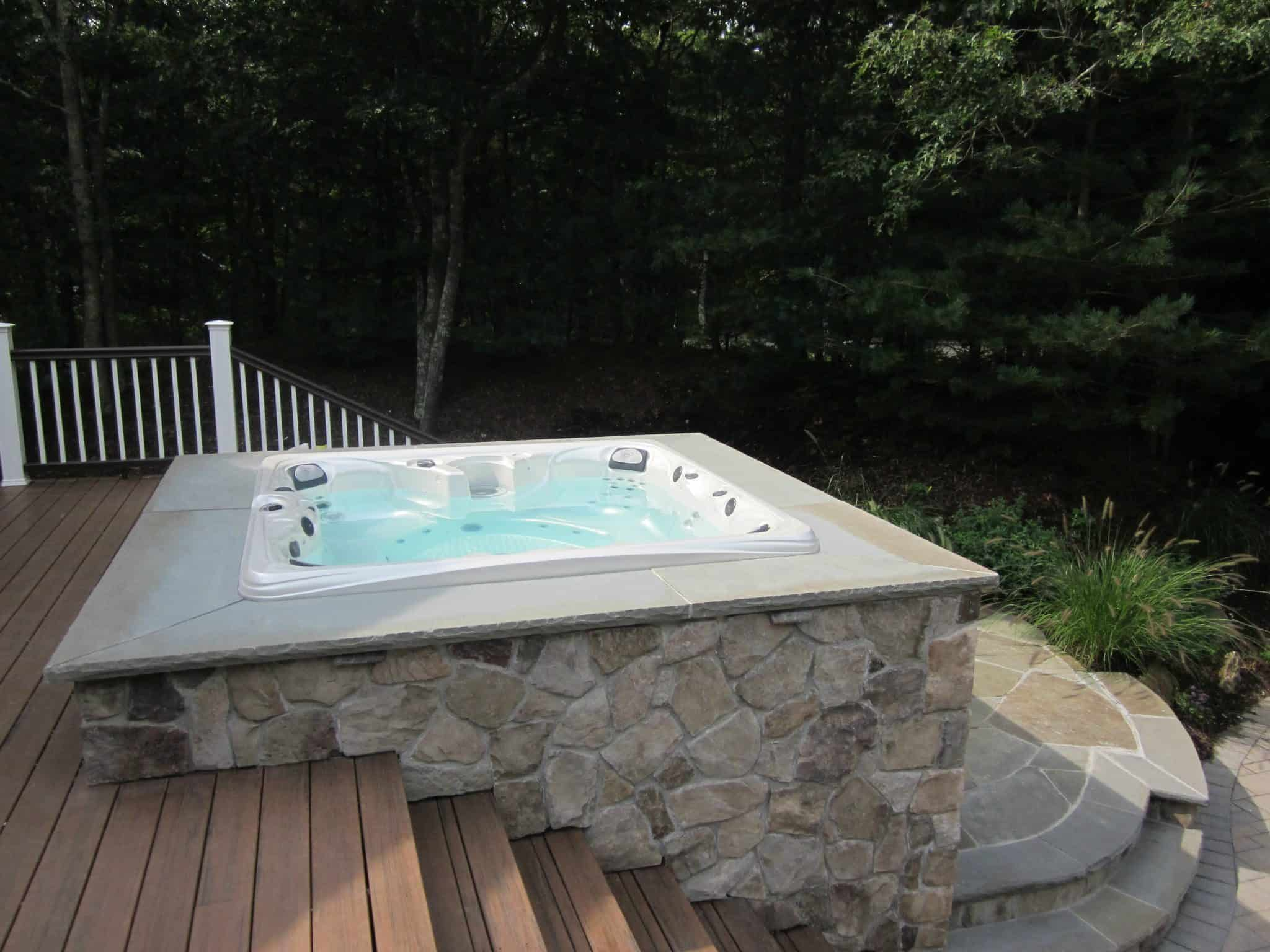 Built in Spa veneered in Dressed Field Stone - Bucks County - with Bluestone coping - Hampton Bays, Long Island NY