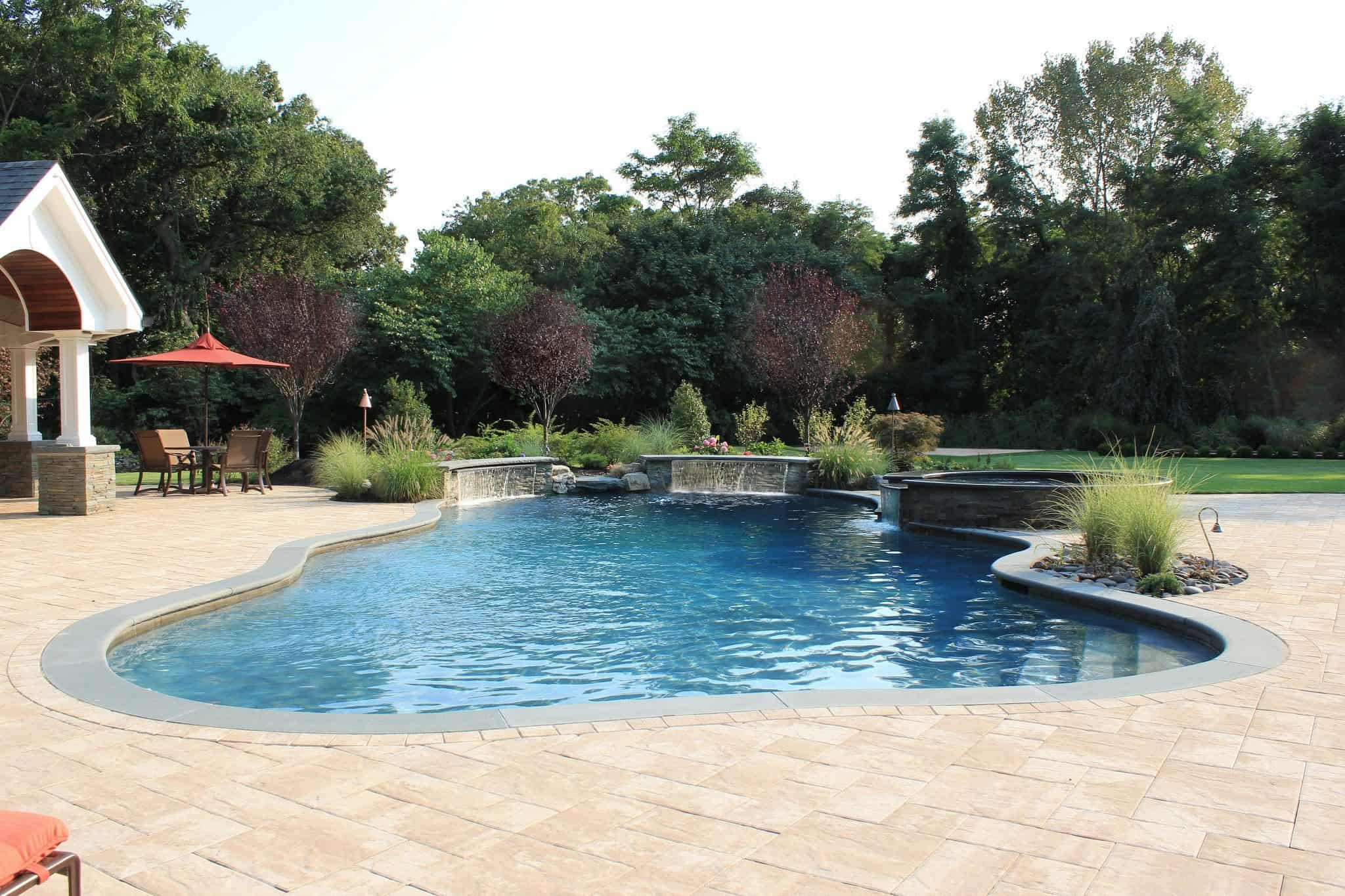Twin 6' Sheer Descent Waterfalls veneered with stacked Bluestone and Rock Faced Bluestone Cap - Old Westbury, Long Island NY