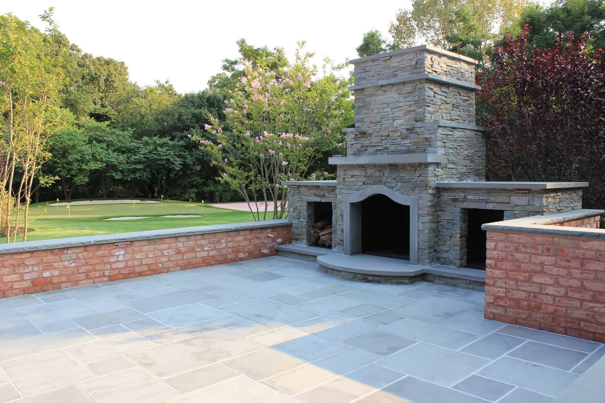 Natural Brick retaining wall with Rock Faced Bluestone Cap - Old Westbury, Long Island NY