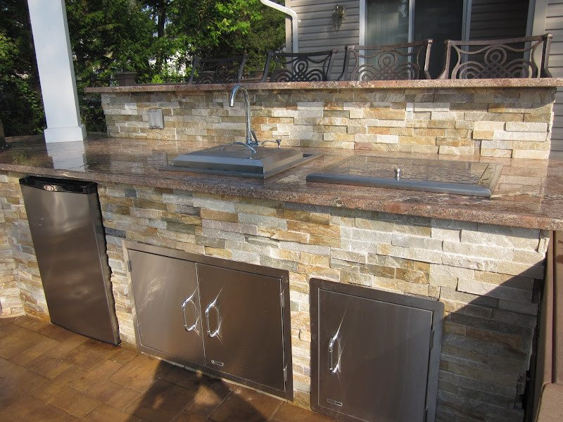 Outdoor Kitchen with bar top veneered in East West Stone - Honey Gold - Granite Countertop - Flanders, Long Island NY