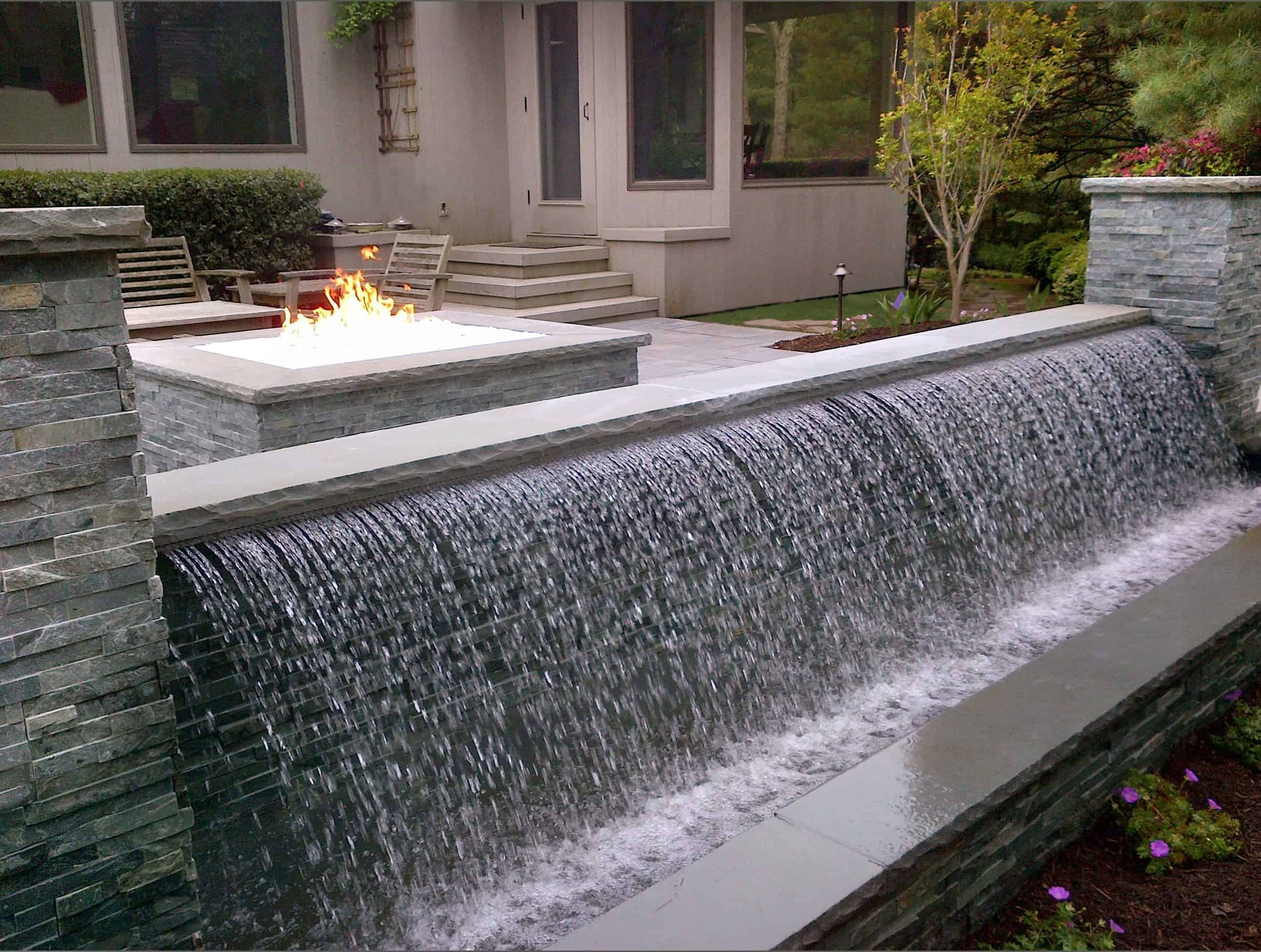 12' Sheer Descent water feature with Bluestone Caps and Real Stone System Veneer - East Hampton, Long Island NY