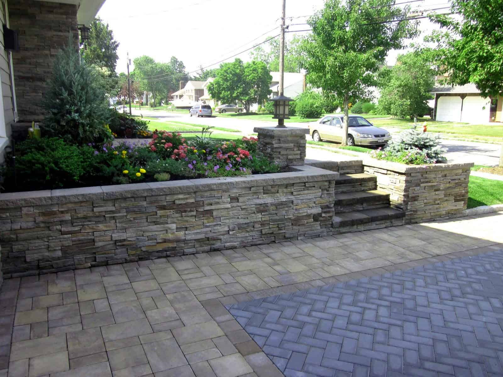 Retaining Wall with Cultured Stone Pro-Fit–Alpine Ledgestone. Color: Pheasant. Capped with Cambridge Splitface Wall cap Toffee/Onyx-color - Massapequa, Long Island NY