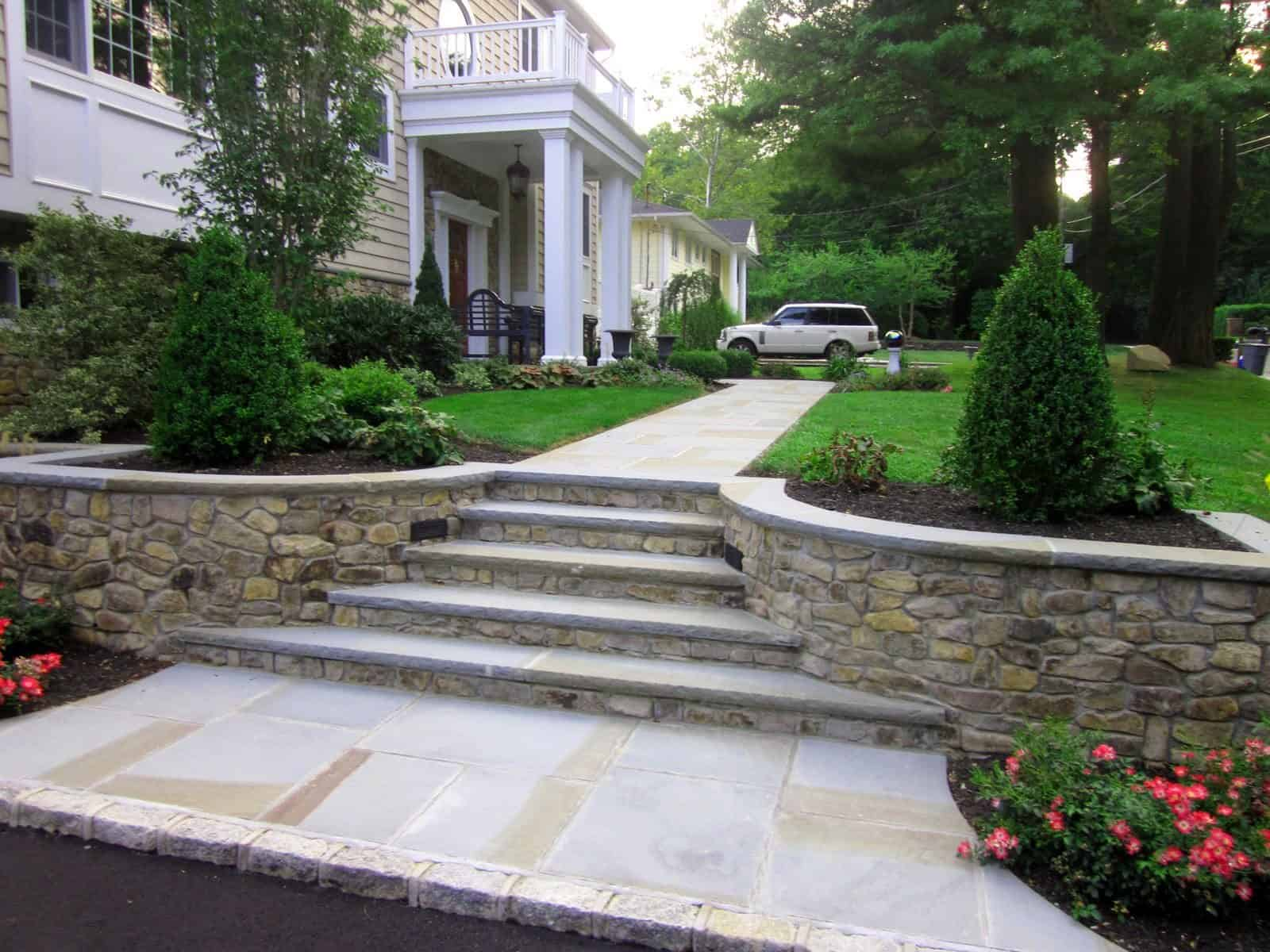 Natural Thin Stone Veneer - PA Ledgestone with Rock Faced Bluestone Cap and Treads - Glen Cove, Long Island NY