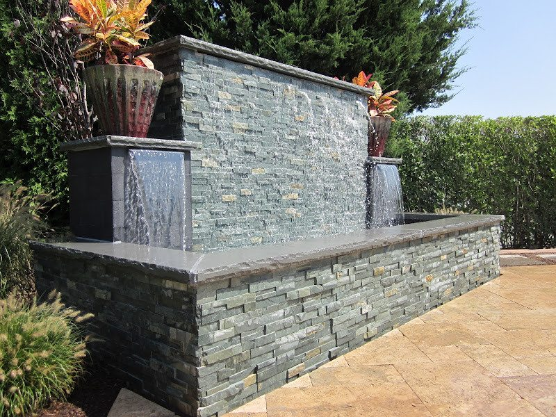 Gunite fountain with East West Stone Waterwall, Black Slate tile Sheer Descents, and rock faced bluestone caps - Southampton, Long Island NY