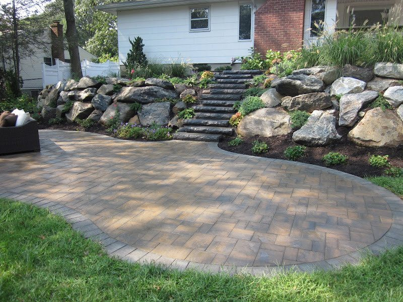Cambridge Cast Stone Steps- Bluestone Blend set into staggered New York State Boulder retaining wall - Smithtown, Long Island NY