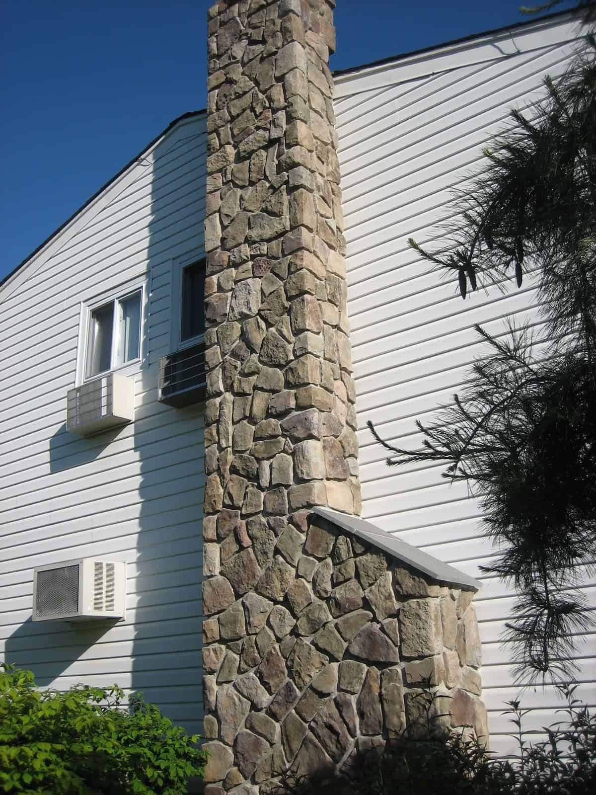 Chimney veneered in Cultured Stone Dressed Fieldstone - Bucks County - with Thermal Bluestone cap - Dix Hills, Long Island NY