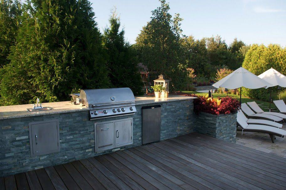 Outdoor Kitchen veneered with East West Stone - Bayside Waters - Eqipped with Bull Stainless Steel sink, Refrigerator, and 38 inch Brahma Grill - Southampton, Long Island NY