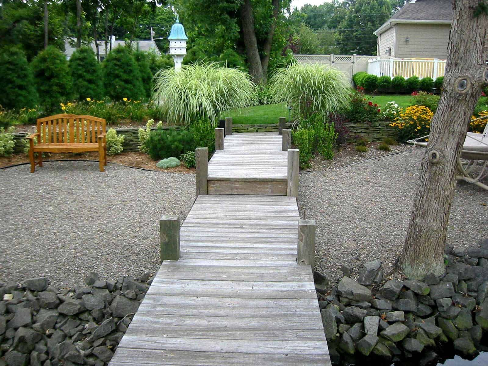 Landscape Plantings - Maiden Grass with Eastern White Pine screening - Babylon, Long Island NY