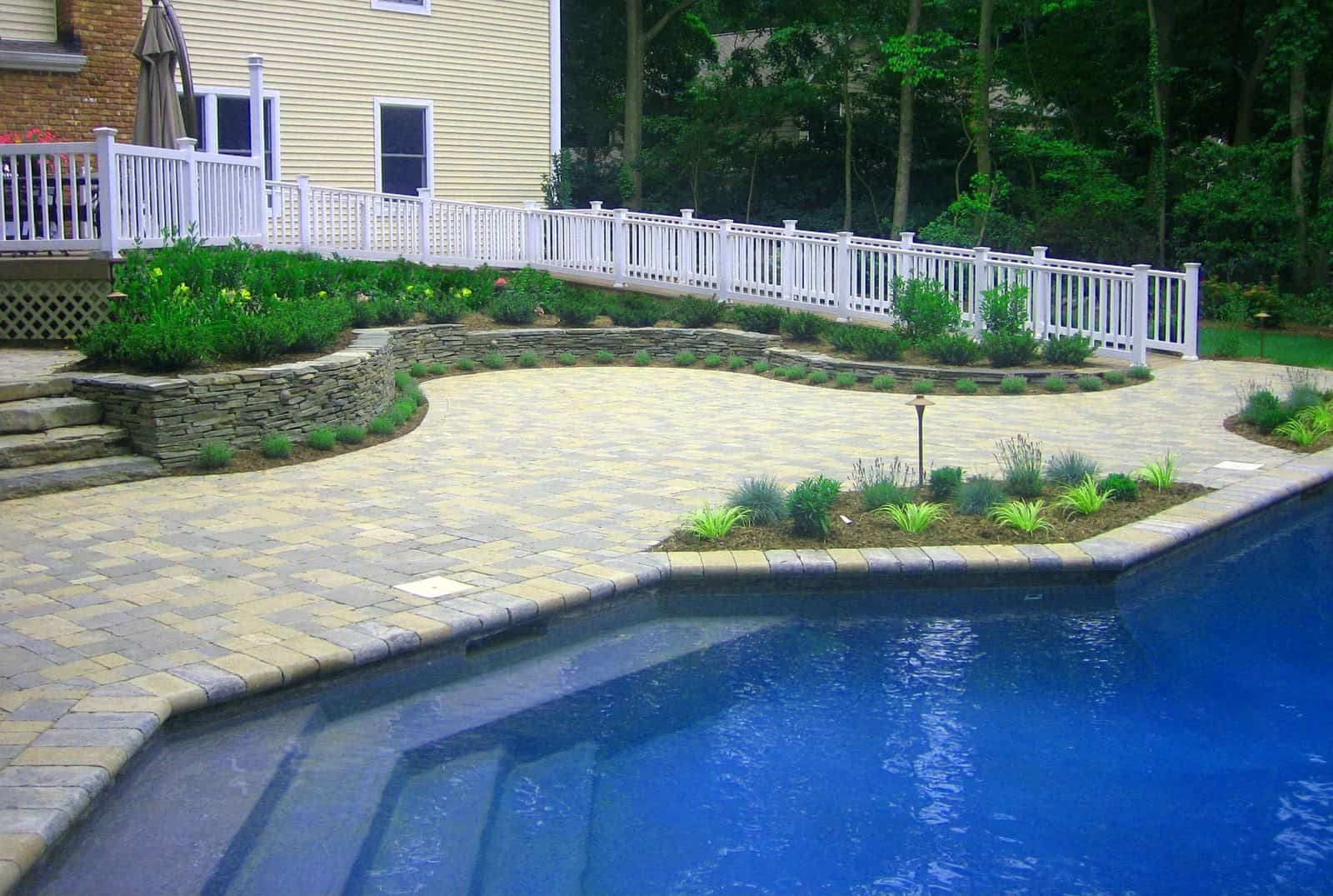 Paver Patio - Unilock Tumbled Brussels Block Pool Patio - Sandstone and Limestone Mix - Random Pattern - Dix Hills, Long Island NY