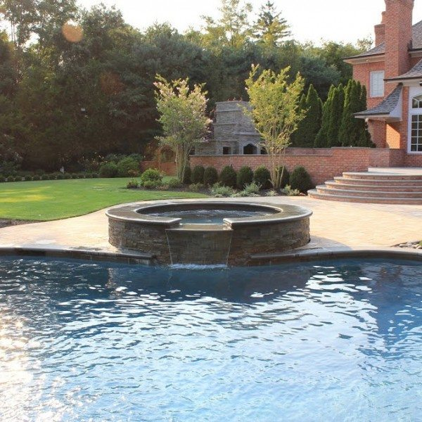 Free Form Custom Gunite Pool with Sheer Descent Waterfalls and Spill Over Gunite Spa