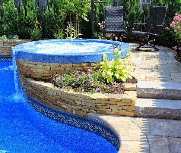Hot Tub with Spill Over and Stone Veneer