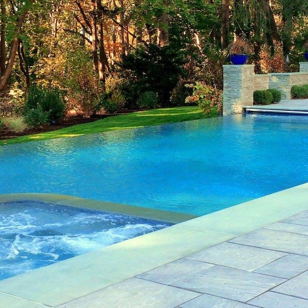 24 x 44 ft. Custom Gunite Pool with 44 ft. Infinity Edge, 8 x 8 ft. Custom Spa, and Automatic Cover