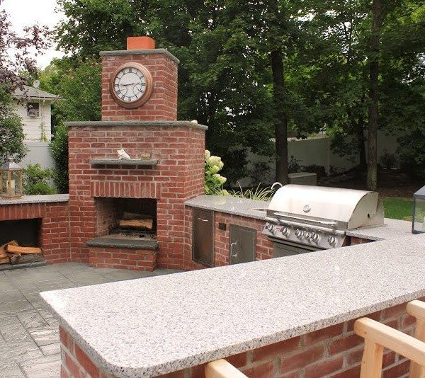 Natural Brick Outdoor Kitchen with Granite Countertop and Fireplace