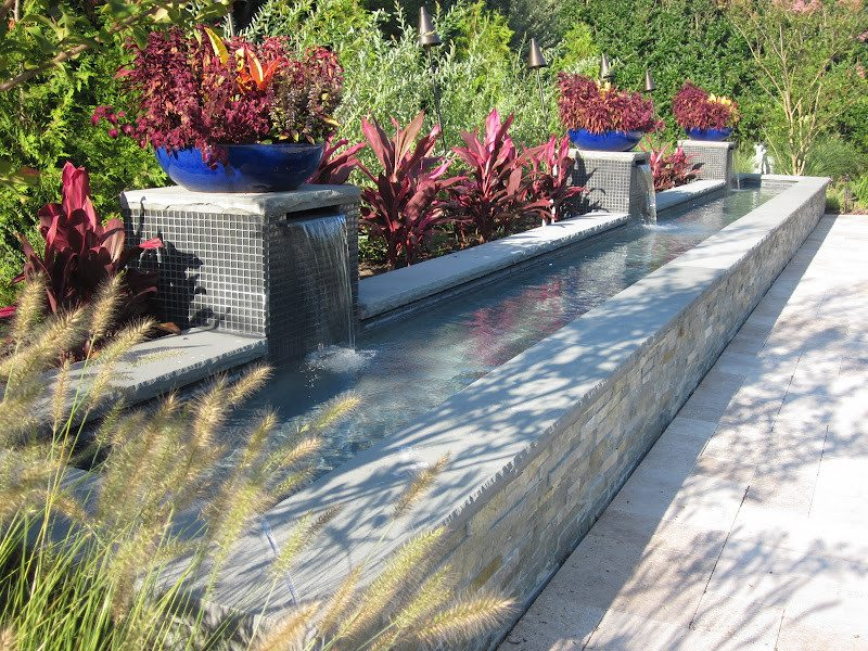 Gunite Reflecting Pools with Sheer Descent Pillars veneered in East West Stone - Bayside Waters and Glass Tile - Southampton, Long Island NY