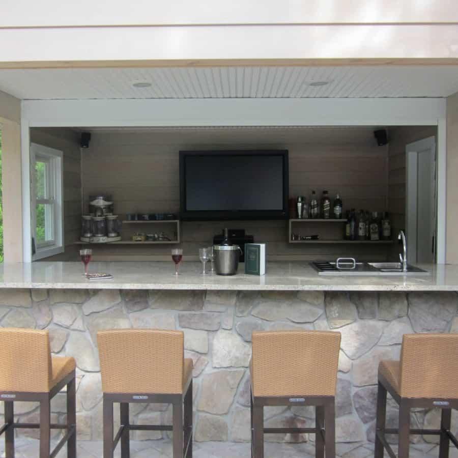 Outdoor bar and granite countertop veneered in Dressed Field Stone - Hampton Bays, Long Island NY