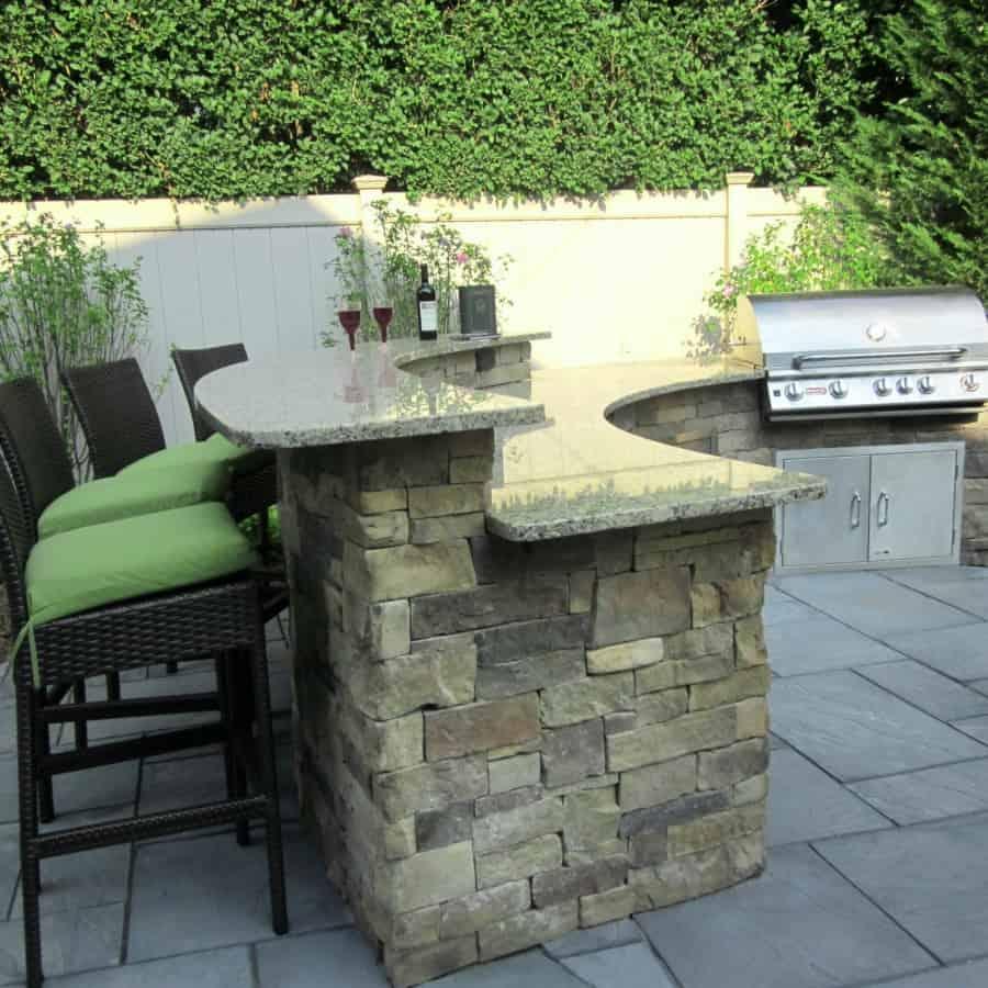 Custom Bi-Level Radial Outdoor Kitchen/Bar veneered with Cambridge - Canyon Ledge - Chestnut - Merrick, Long Island NY