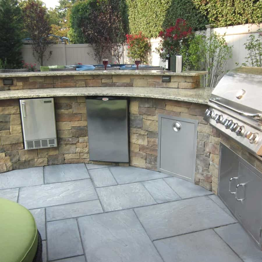 Custom Bi-Level Radial Outdoor Kitchen/Bar veneered with Cambridge - Canyon Ledge - Chestnut - Merrick, Long Island NY