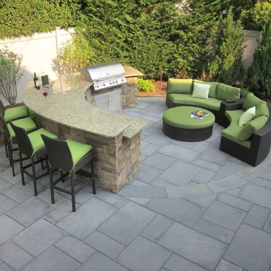 Custom Bi-Level Radial Outdoor Kitchen and Bar veneered with Cambridge - Canyon Ledge - Chestnut - Merrick, Long Island NY