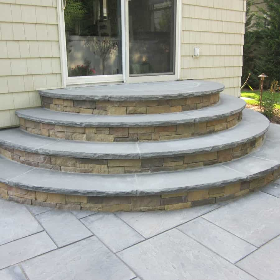 Radial stoop veneered with Cambridge - Canyon Ledge - Chestnut - with Rock Faced Bluestone treads - Merrick, Long Island NY