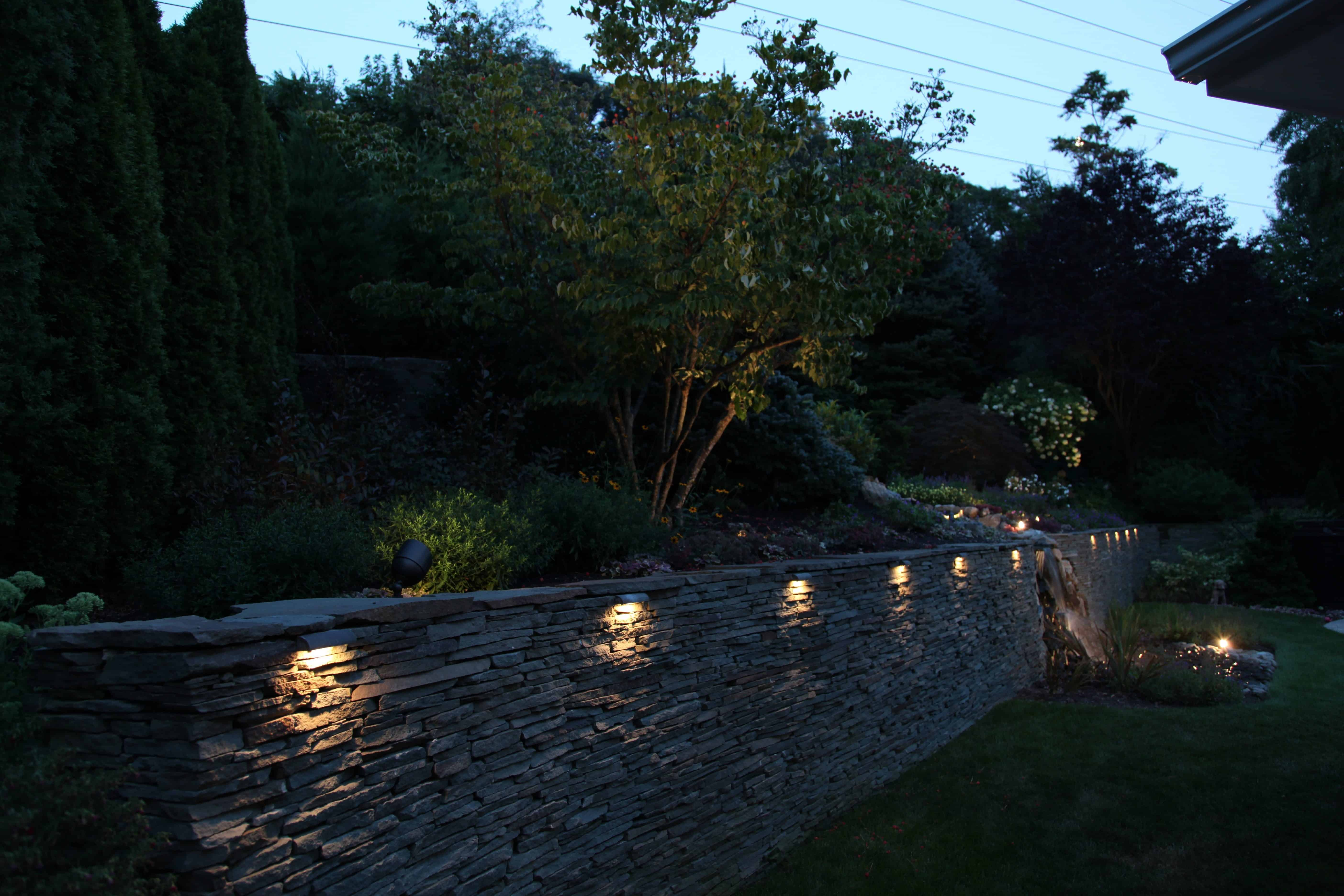 Natural Stacked Bluestone Retaining Wall with Moss Rock accents - Roslyn, Long Island NY