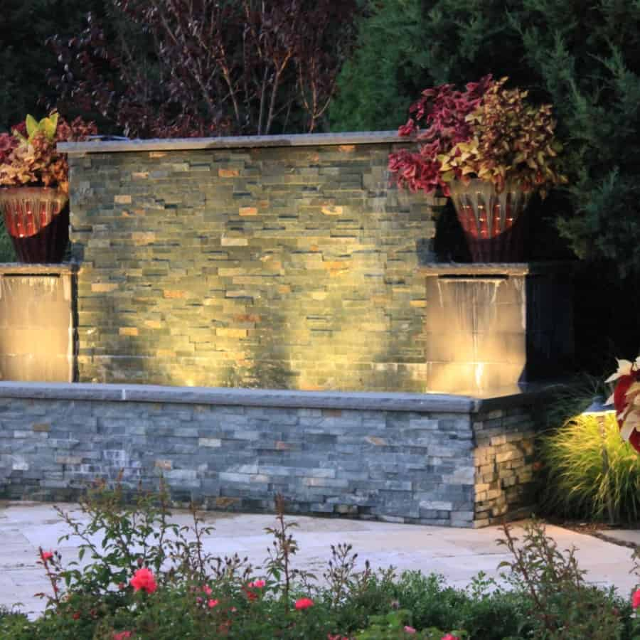 Gunite fountain vennered with East West Stone Waterwall, Black Slate tile Sheer Descents, and rock faced bluestone caps