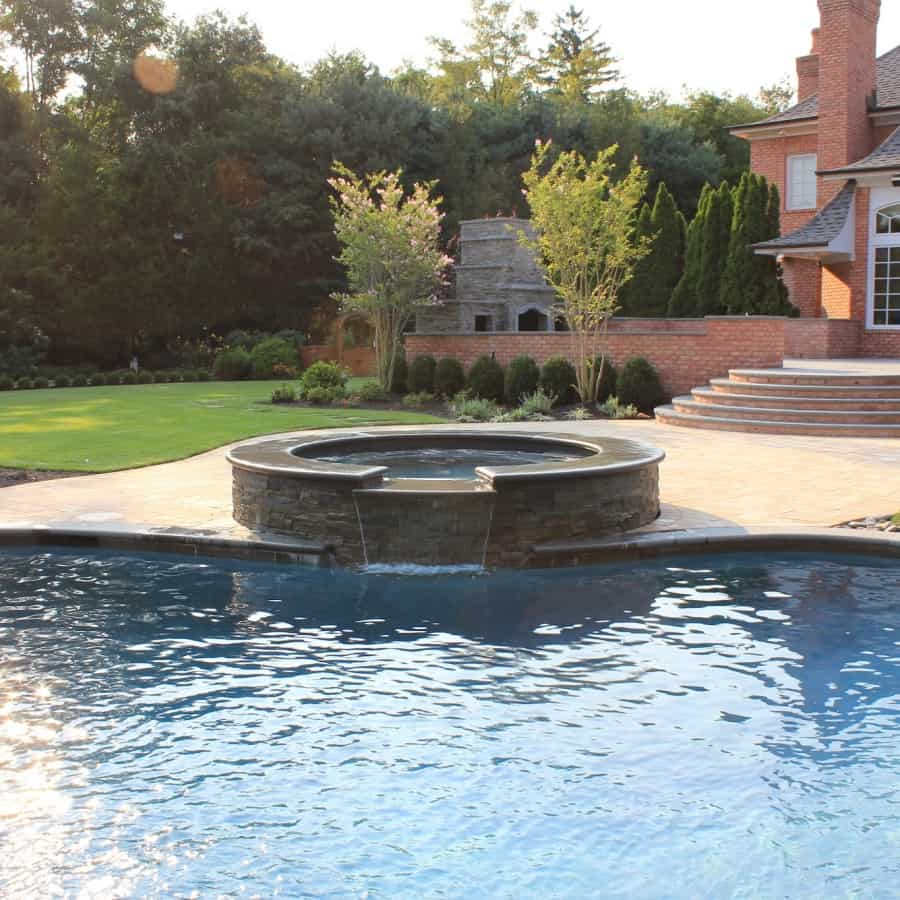 Sheer Descent Hot Tub Spill Over veneered with stacked Bluestone and Radial Bluestone Cap - Old Westbury, Long Island NY