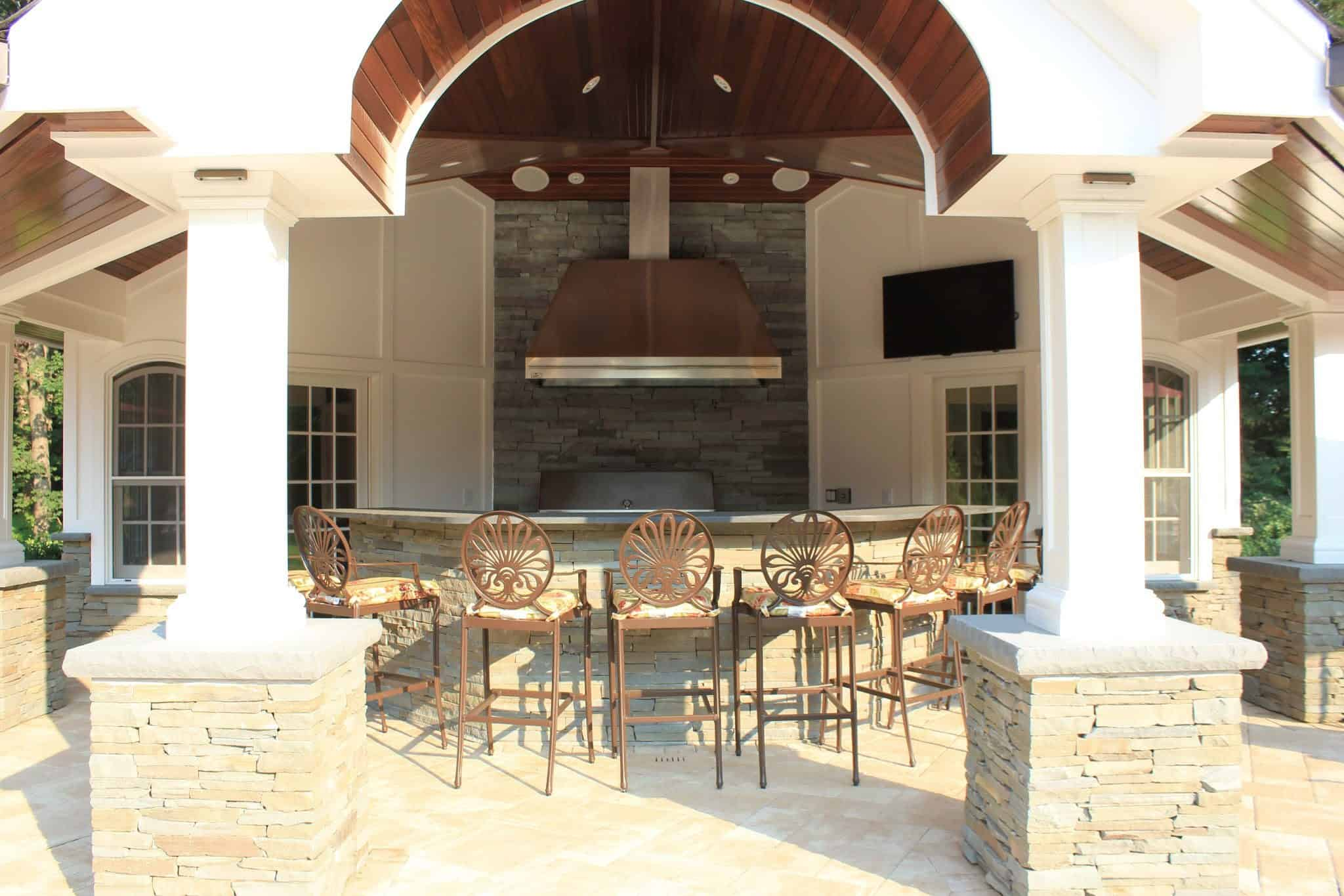 Stacked Bluestone Pillars and Outdoor Kitchen with Rock Faced Bluestone Cap - Old Westbury, Long Island NY