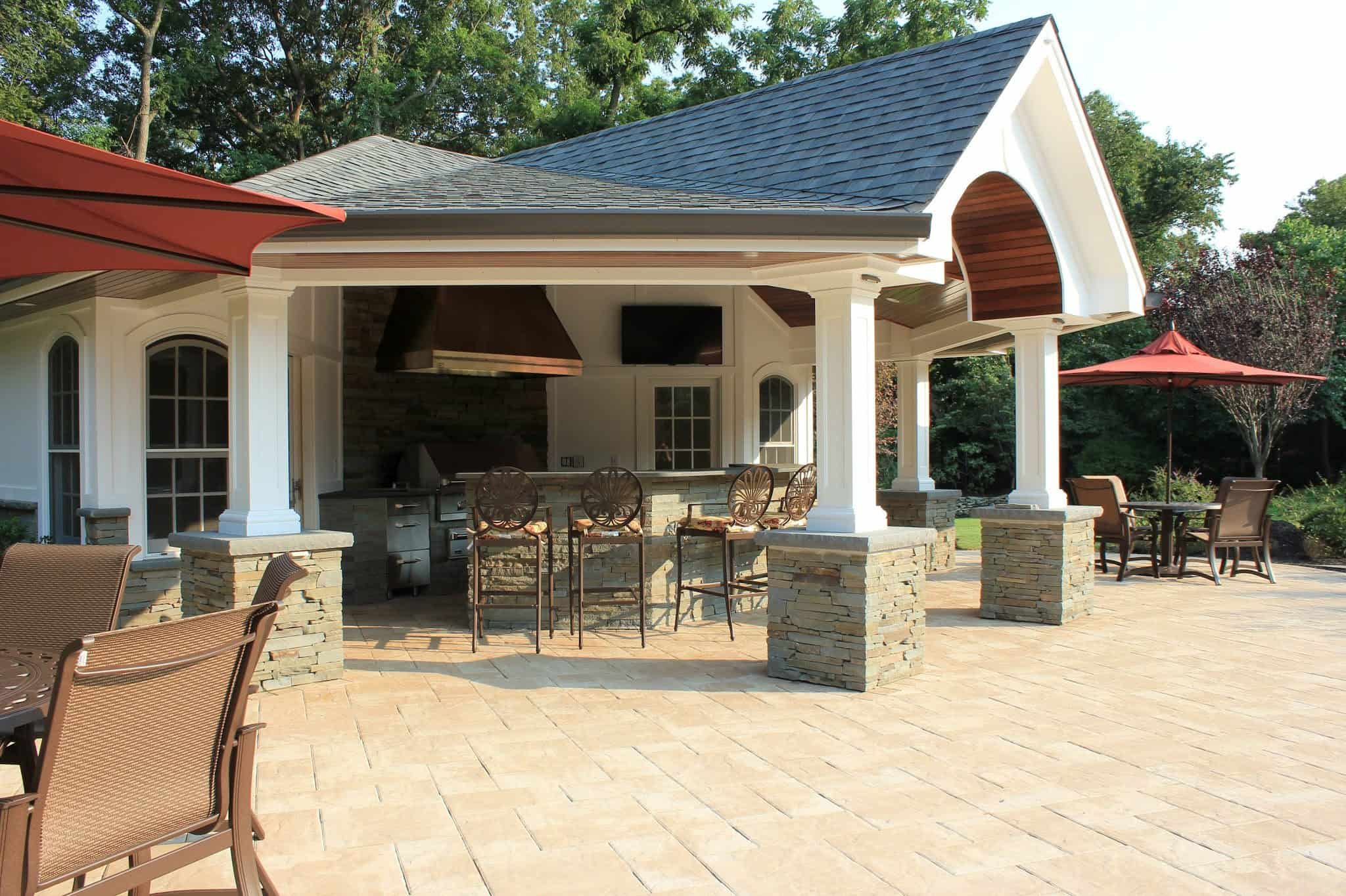 Outdoor Kitchen With Bar And Roof