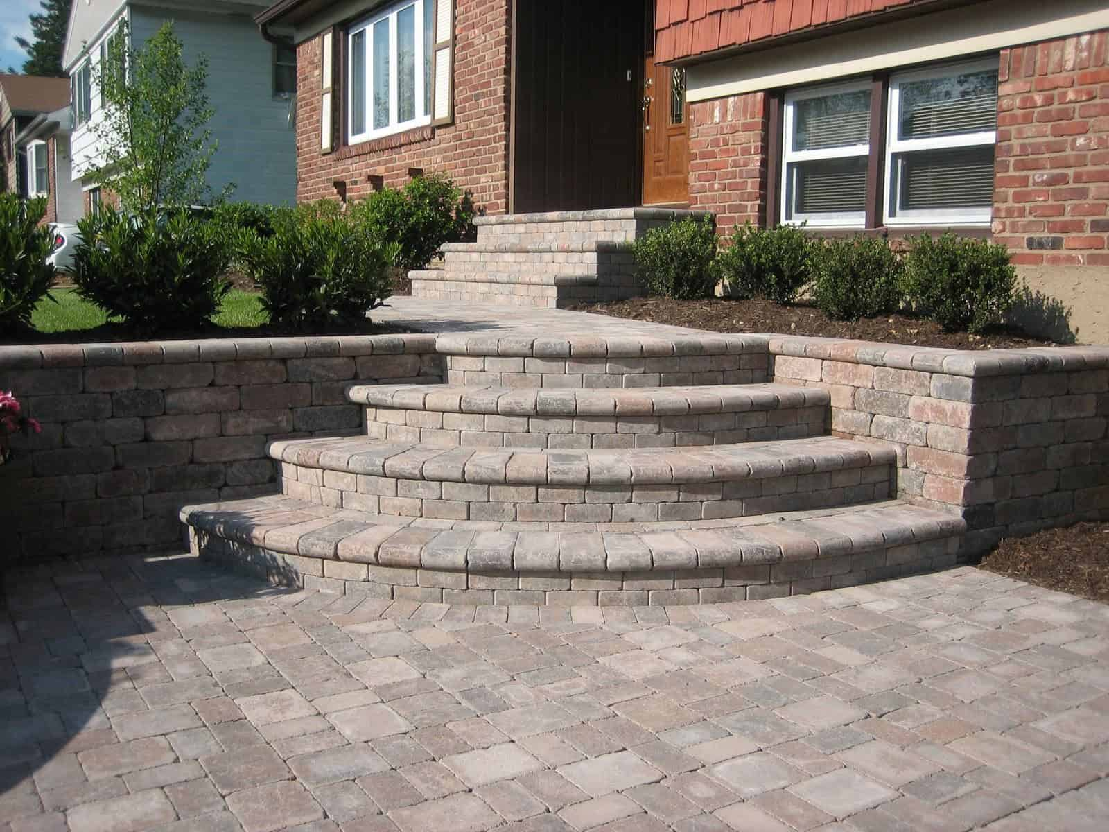 Wedding Cake steps - Unilock Fullnose - Color - Terra Cota - Retaining Wall - Unilock Dimesional Tumbled Wall System - Color - Terra Cota - Walkway Unilock Brussels Block Tumbled Paver - Color - Terra Cota