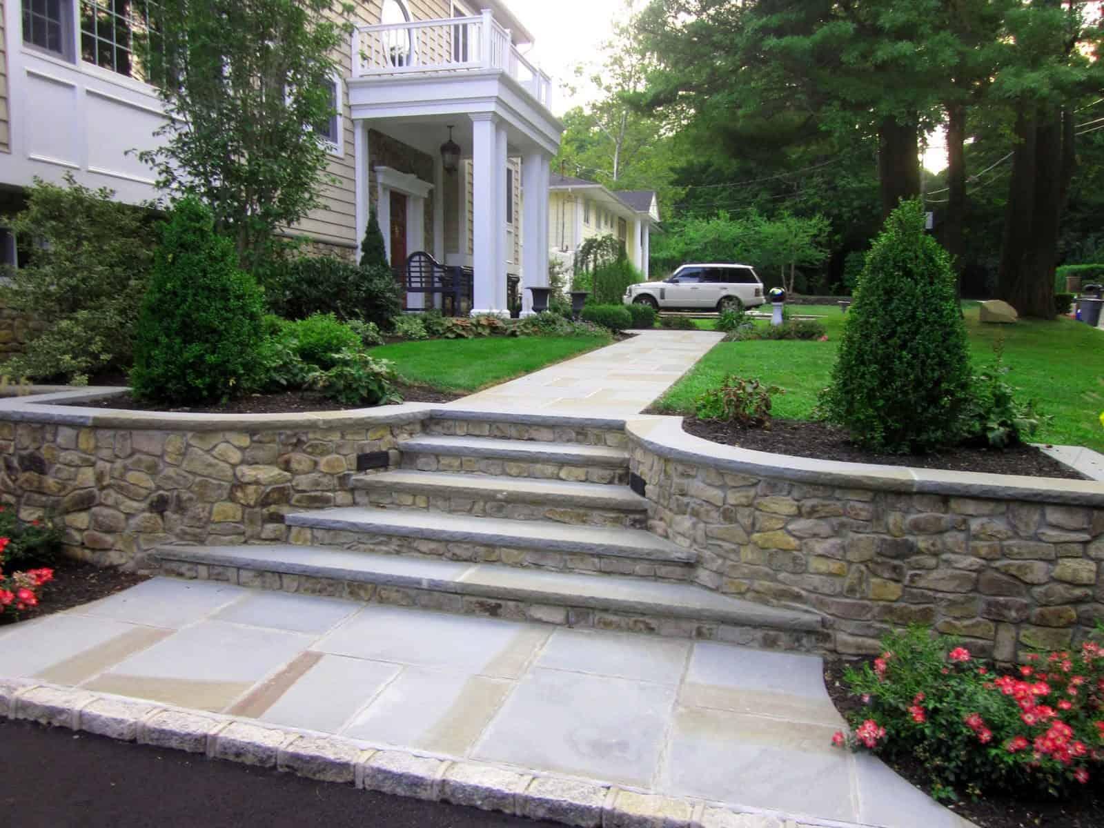 Natural Thin Stone Veneer - PA Ledgestone with Rock Faced Bluestone Cap and Treads - Glen Cove, Long Island NY