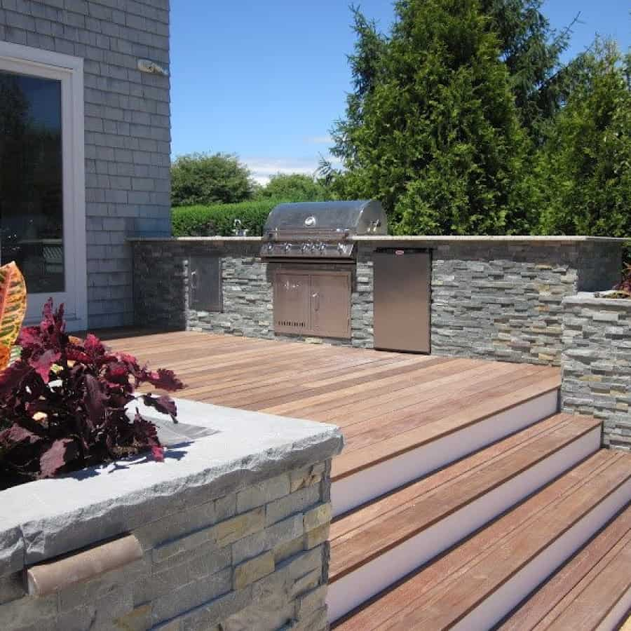 Outdoor Kitchen and planter box veneered in East West Stone - Bayside Waters - Southampto​n, Long Island NY