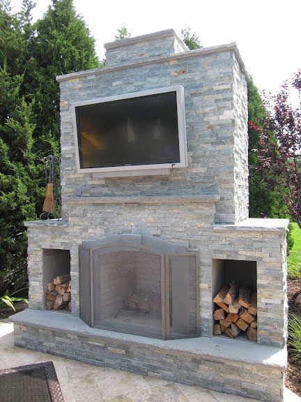 Outdoor Fireplace with Outdoor Television veneered in East West Stone - Bayside Waters - Southampton, Long Island NY