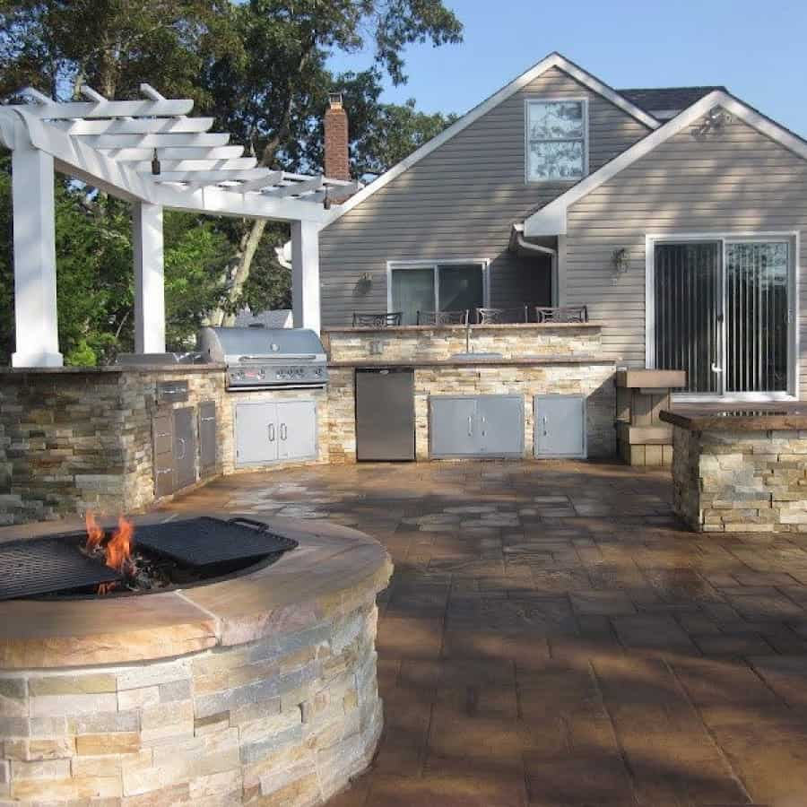 Fire Pit Veneered with East West Stone Veneer- Honey Gold - and capped with Rainbow Stone with rock faced Edge - Flanders, Long Island NY