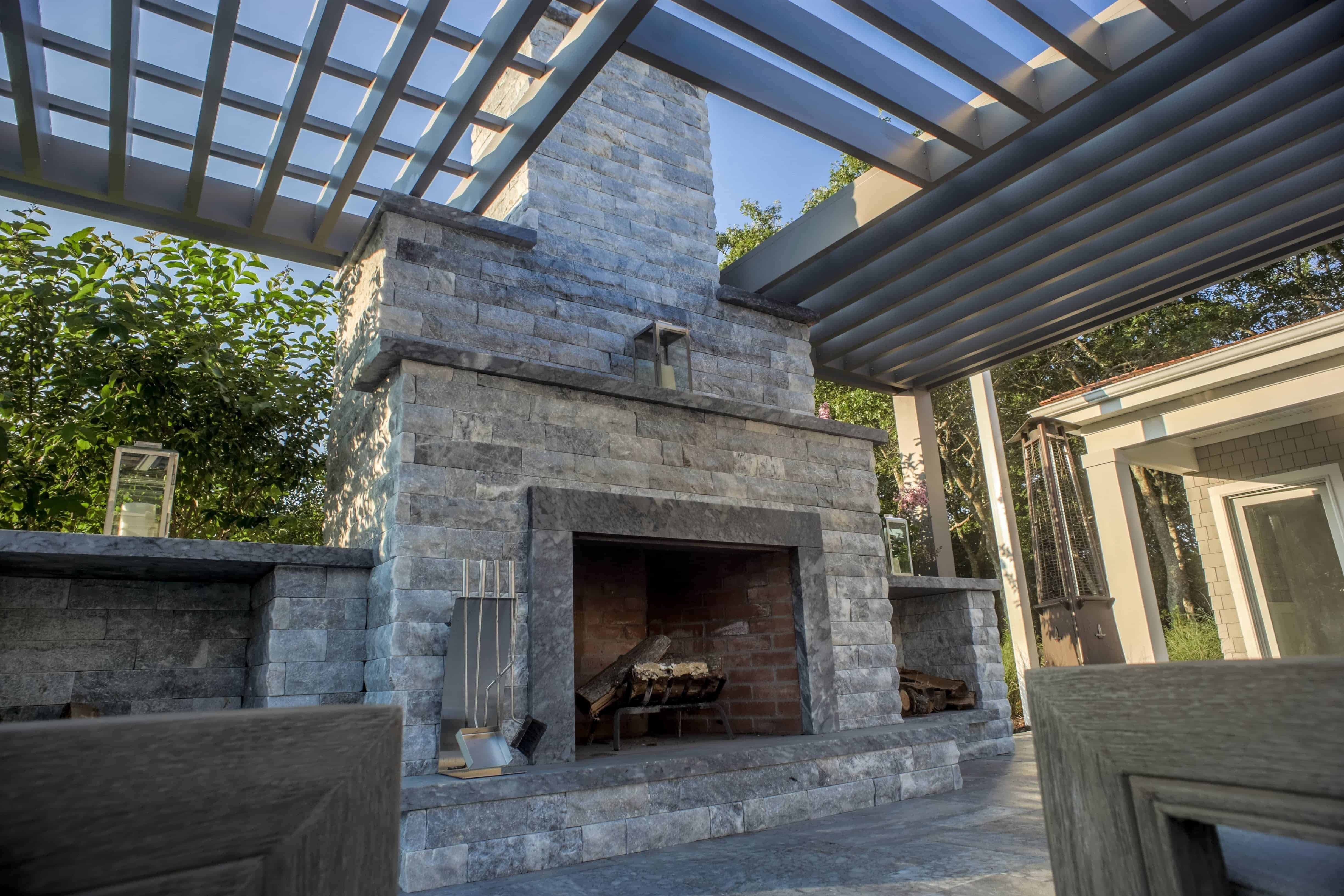 Grand Outdoor Fireplace with Pergola - Marmiro Stone Deep Blue - Southampton, Long Island NY