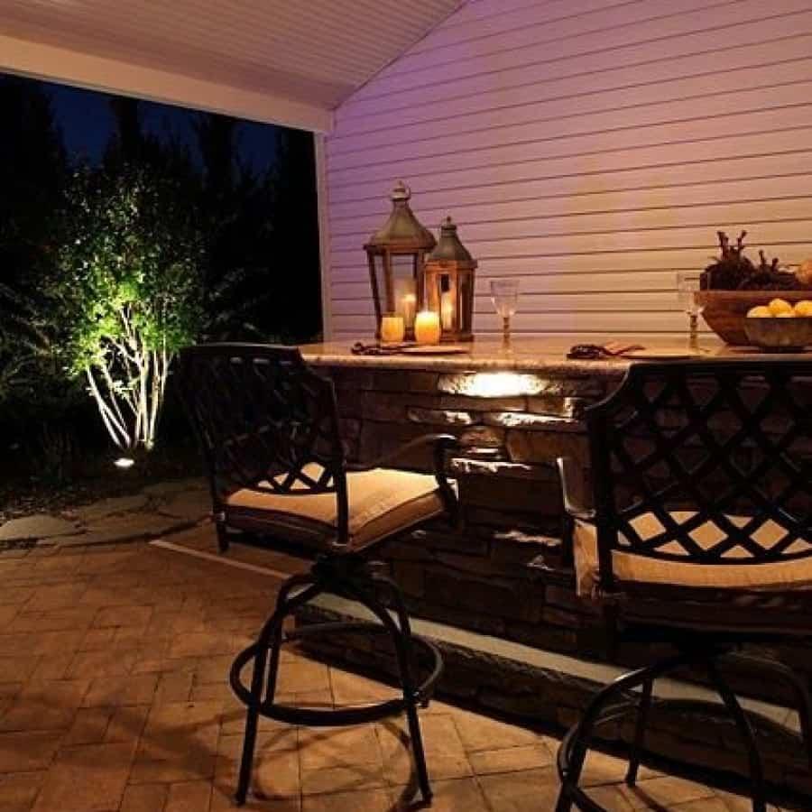 8' Custom Bar veneered with Cultured Stone Ledgestone veneer, Granite countertop, Bull stainless steel sink, custom cabinets, and Rockfaced Bluestone footrest - Dix Hills, Long Island NY
