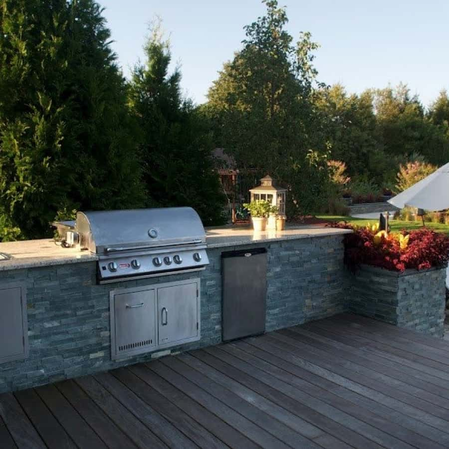 Outdoor Kitchen and planter box veneered in East West Stone - Bayside Waters - Southampton, Long Island NY