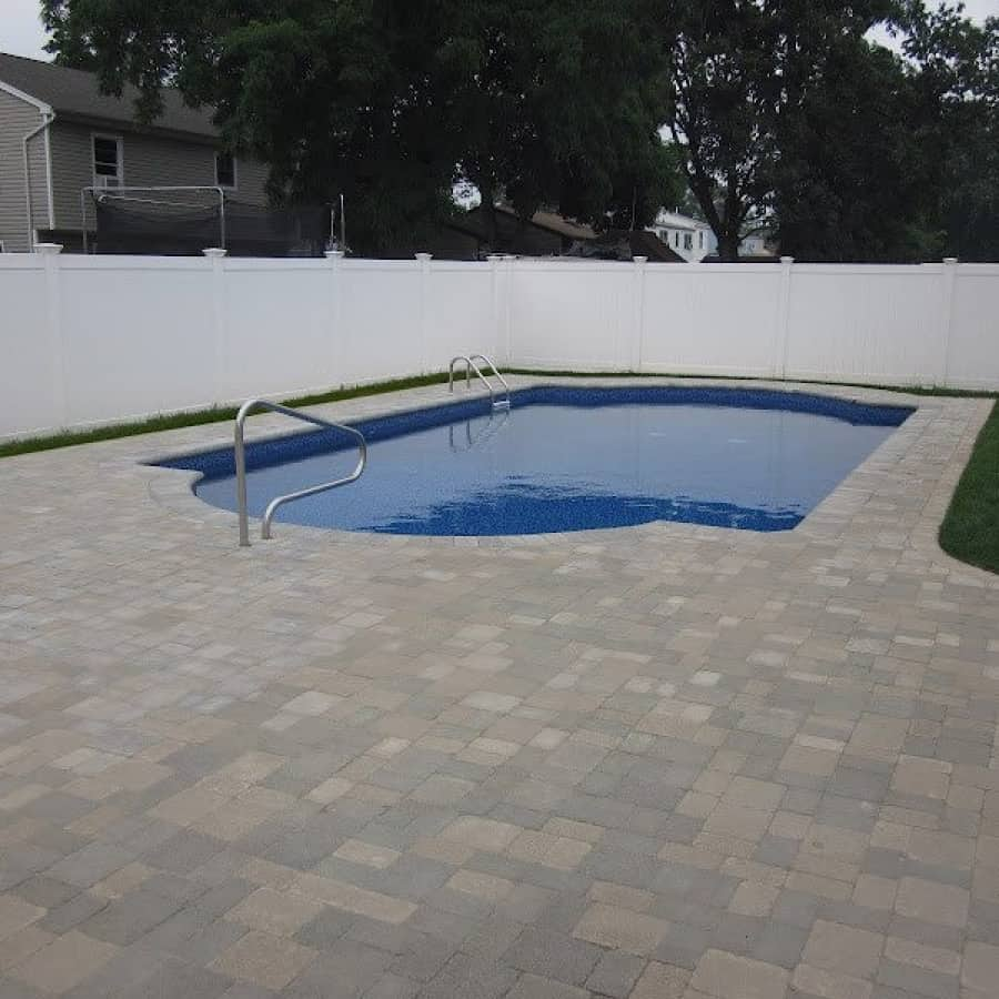Paver Patio - Unilock Tumbled Brussels Block Pool Patio - Sandstone and Limestone Mix - Fullnose Coping - Lindenhurst, Long Island NY