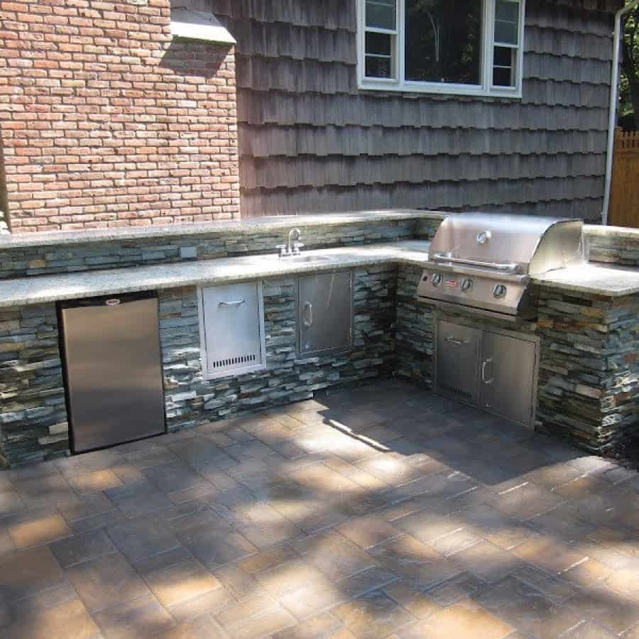 Outdoor Kitchen with bar top and granite countertop veneered in East West Stone - Bayside Waters - Dix Hills, Long Island NY