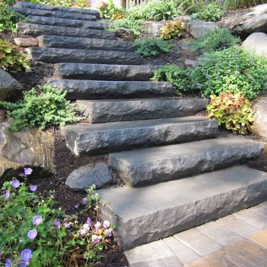 Paver Steps - Cambridge Cast Stone Steps- Bluestone Blend set into staggered New York State Boulder retaining wall - Smithtown, Long Island NY